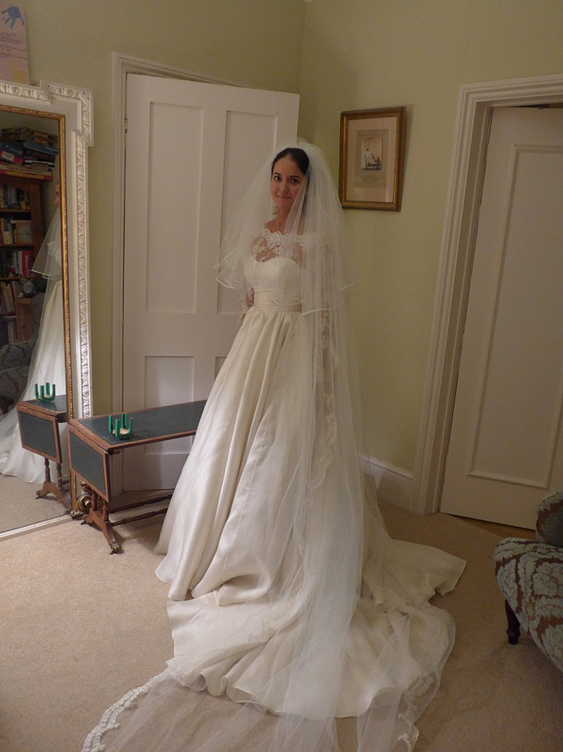 Fitting picture of custom wedding dress and veil