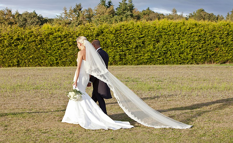 classic traditional wedding gown with train and long veil lace edge