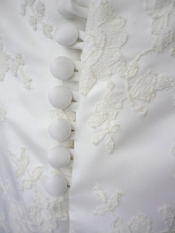 real button and loop fastening closure detail satin bespoke wedding dress