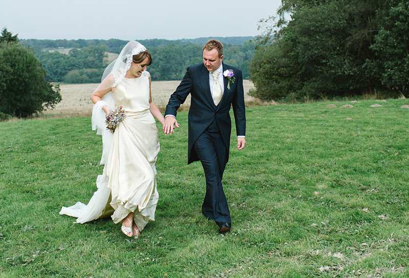 lifting the hem pale gold wedding bespoke dress